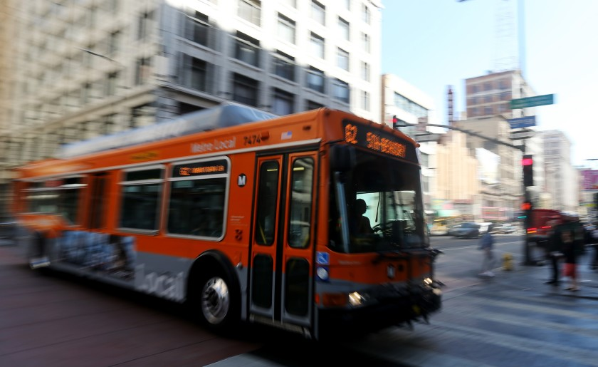 A bus motors down Third Street in downtown Los Angeles in the file photo. (Los Angeles Times)