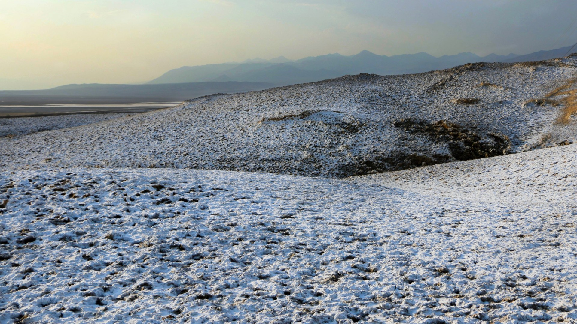 A snow-like dusting at Death Valley National Park was caused by rain soaking into the soil and dissolving salt beneath the surface, rangers said.(M. Gage / National Park Service)