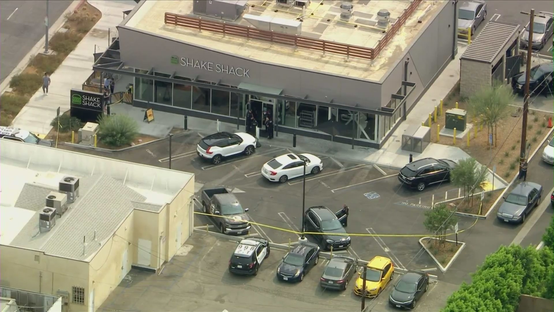Authorities investigate after a man shot out windows of a Shake Shack in Canoga Park on Sept. 23, 2021. (KTLA)