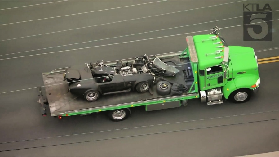 A mangled vehicle is seen being towed after a deadly crash in Temple City early Sept. 16, 2021. (KTLA)