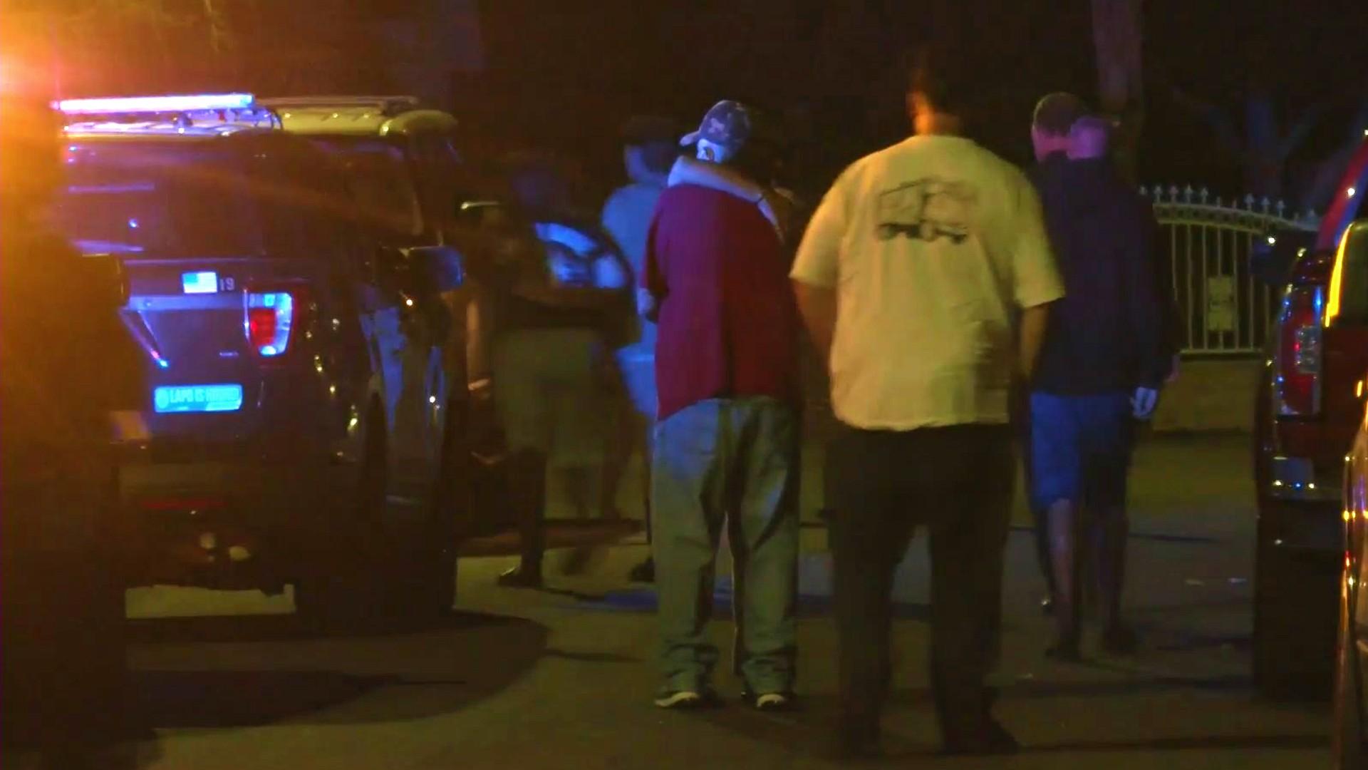 People gather during a homicide investigation in Sylmar on Sept. 7, 2021. (KTLA)