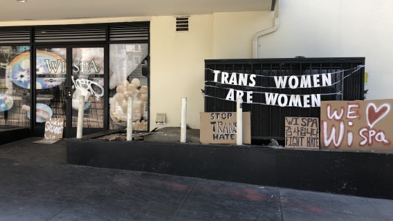Signs are placed outside the Wi Spa in Koreatown in July, 2021. (Adam Elmahrek / Los Angeles Times)