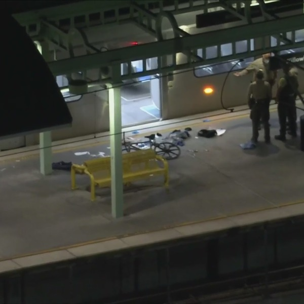 Investigators respond to a Willowbrook Metro station where four people were injured in a shooting on Sept. 24, 2021. (KTLA)
