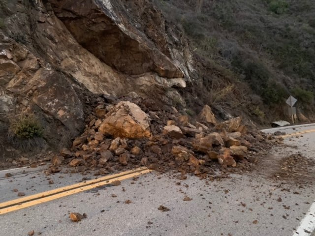 In this photo provided by Caltrans, is a rockslide on the central coast that forced closure of a long stretch of Highway 1 near Big Sur, Calif., on Oct. 27, 2021. (Caltrans via AP)