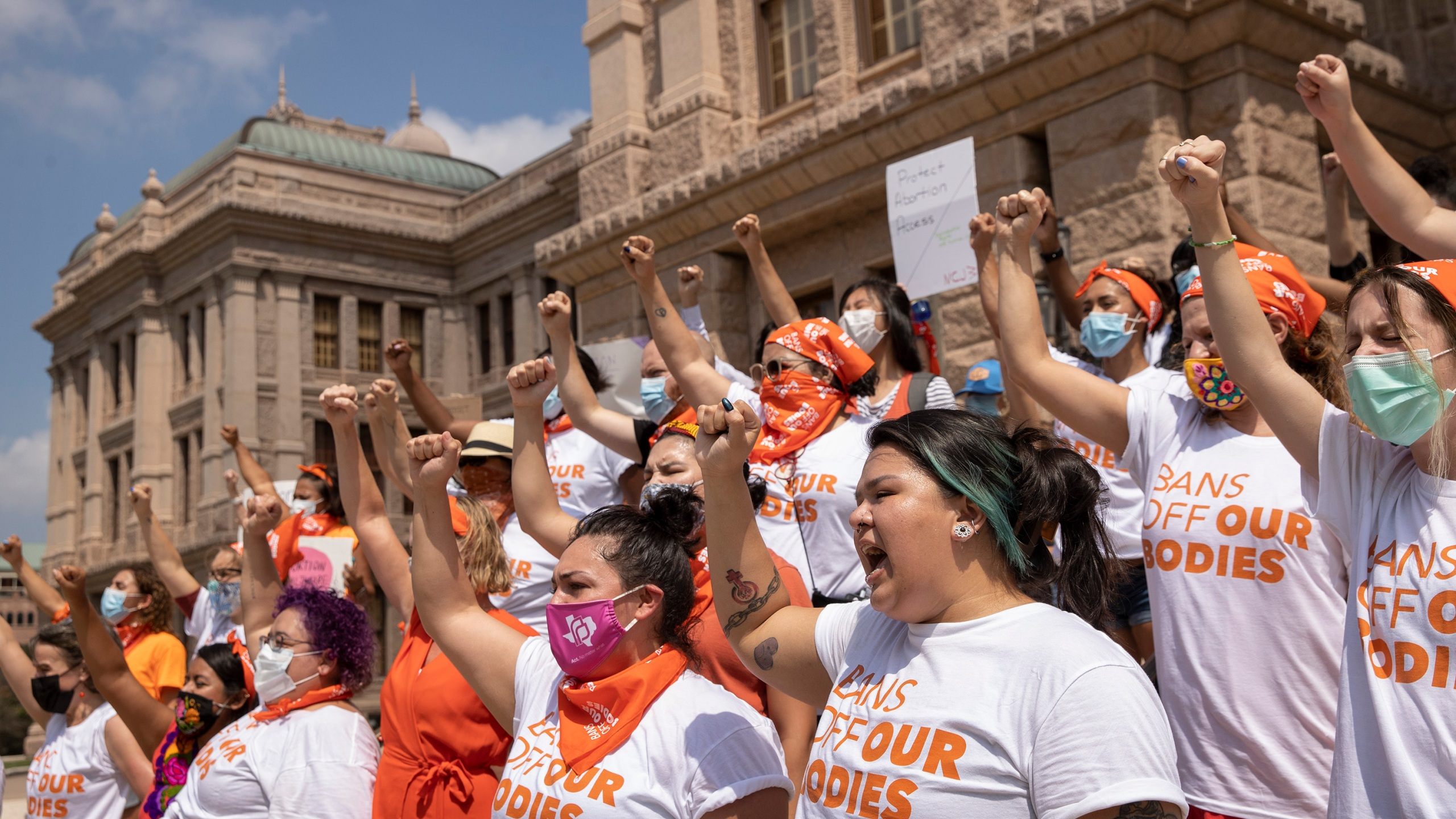 In this Wednesday, Sept. 1, 2021, file photo, women protest against Texas' restrictive abortion law at the Capitol in Austin, Texas. (Jay Janner/Austin American-Statesman via AP)