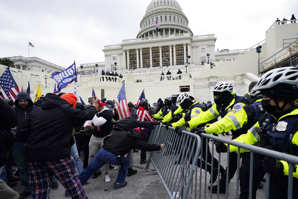 In this Jan. 6, 2021 file photo, Trump supporters try to break through a police barrier at the Capitol in Washington. (AP Photo/Julio Cortez)