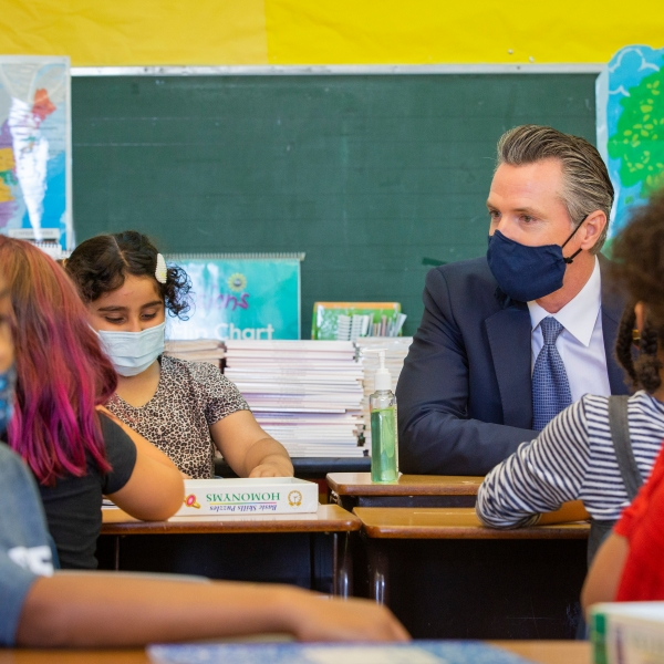 In this Aug. 11, 2021, file photo, California Gov. Gavin Newsom sits among students of a second-grade classroom at Carl B. Munck Elementary School, in Oakland, Calif. (Santiago Mejia/San Francisco Chronicle via AP, Pool, File)