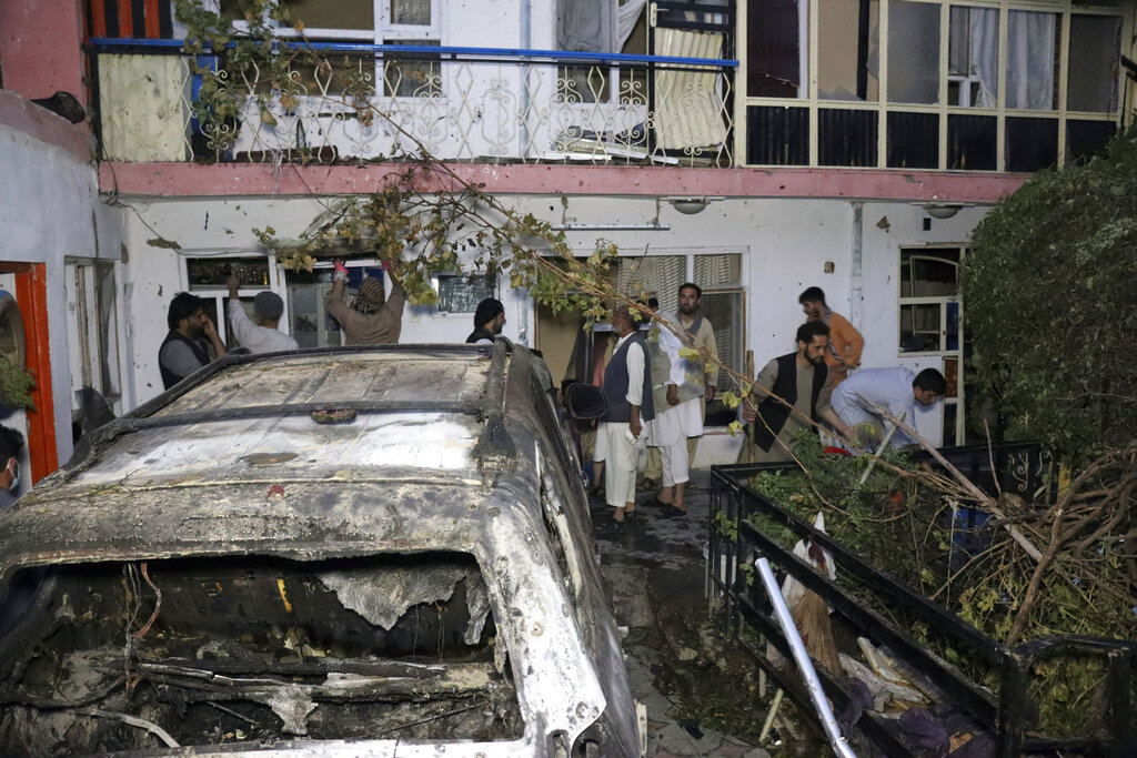 In this Sunday, Aug. 29, 2021 file photo, Afghans inspect damage of Ahmadi family house after U.S. drone strike in Kabul, Afghanistan. (AP Photo/Khwaja Tawfiq Sediqi, File)