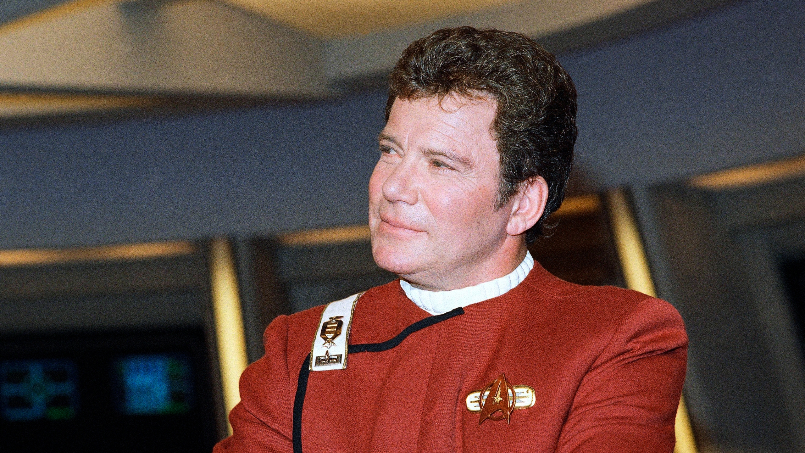 """In this 1988 file photo, William Shatner, who portrays Capt. James T. Kirk, attends a photo opportunity for the film """"Star Trek V: The Final Frontier."""" Star Trek's Captain Kirk is rocketing into space this month — boldly going where no other sci-fi actors have gone. Jeff Bezos' space travel company, Blue Origin, announced Monday, Oct. 4, 2021 that Shatner will blast off from West Texas on Oct. 12. (AP Photo/Bob Galbraith)"""