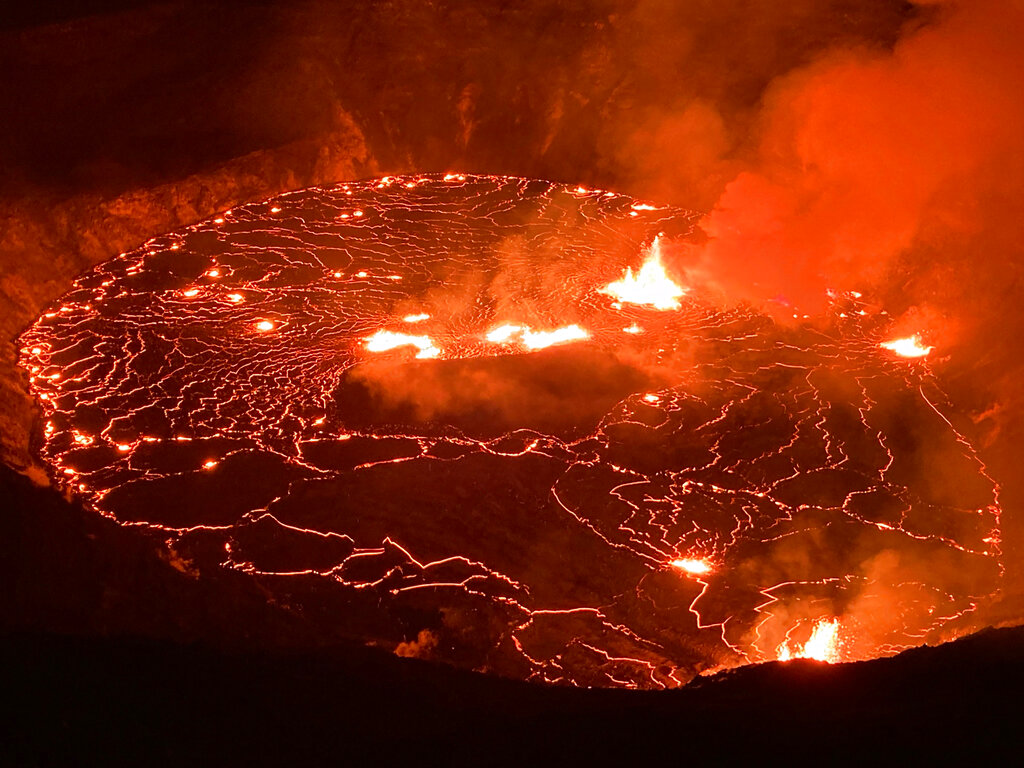 This photo provided by USGS Volcanoes shows the eruption within in Kilauea volcano's Halemaumau crater at the volcano's summit on Wednesday, Sept. 29, 2021. (USGS via AP)