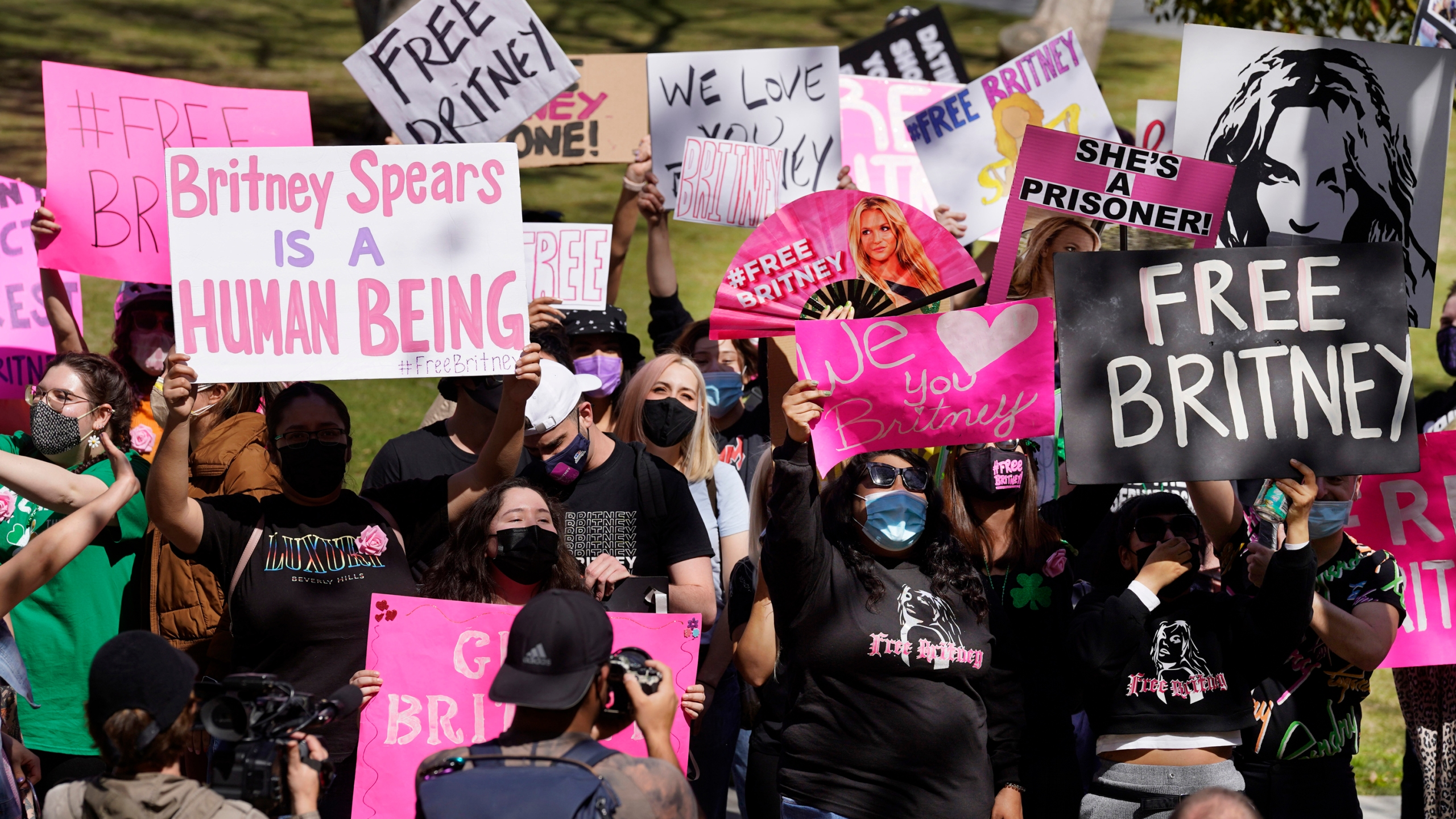 In this March 17, 2021 file photo Britney Spears fans hold signs outside a court hearing concerning the pop singer's conservatorship at the Stanley Mosk Courthouse, in Los Angeles. (Chris Pizzello/Associated Press)