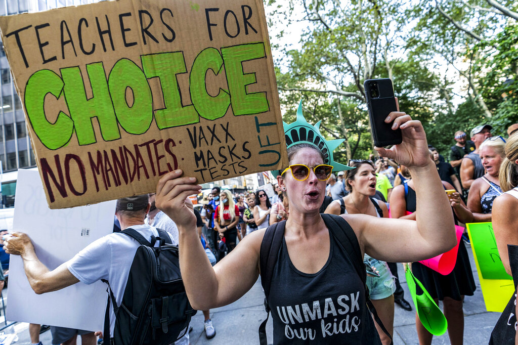 Teachers protest against the COVID-19 vaccination mandates in New York on Wednesday Aug. 25, 2021. (AP Photo/Mary Altaffer, File)