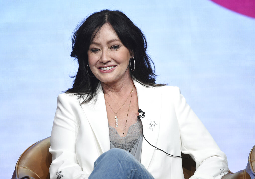 """Shannen Doherty participates in Fox's """"BH90210"""" panel at the Television Critics Association Summer Press Tour on Aug. 7, 2019, in Beverly Hills, Calif. (Chris Pizzello/Invision/AP, File)"""