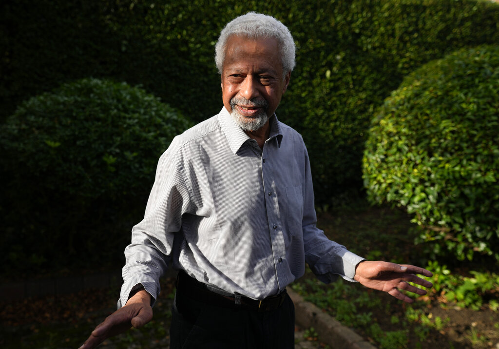 Tanzanian writer Abdulrazak Gurnah gestures as he poses for a photo at his home in Canterbury, England, Thursday, Oct. 7, 2021. (AP Photo/Frank Augstein)