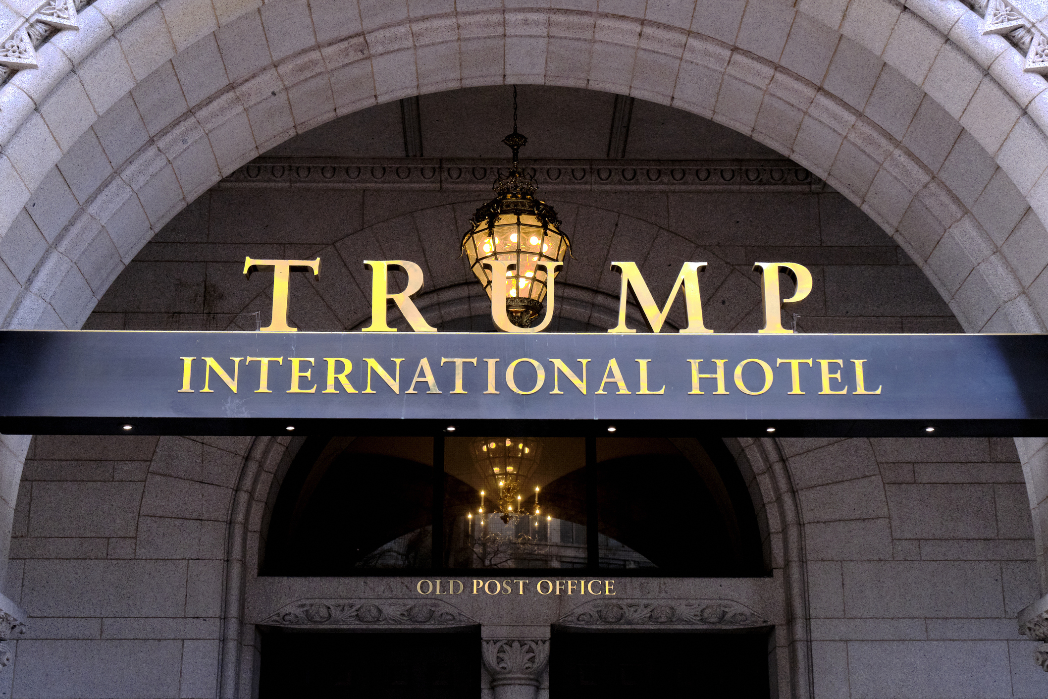 This March 11, 2019 file photo, shows the north entrance of the Trump International in Washington. Former President Donald Trump's company lost more than $70 million operating his Washington D.C. hotel while in office, forcing him at one point get a reprieve from a major bank on payments on a loan, according to documents released Friday, Oct. 8, 2021, by a House committee investigating his business. (AP Photo/Mark Tenally, File)