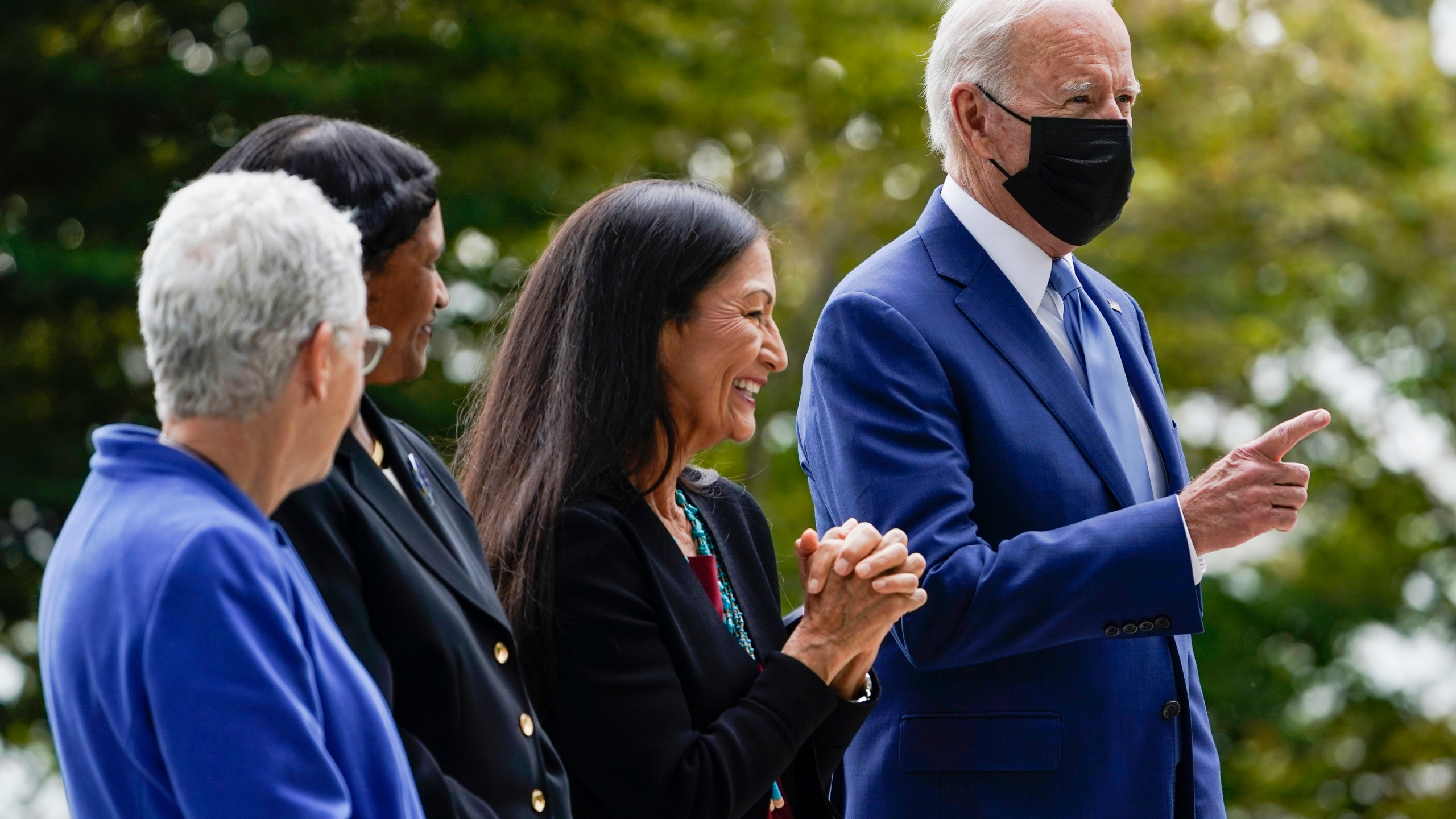President Joe Biden gestures on the North Lawn of the White House on Oct. 8, 2021, with White House national climate adviser Gina McCarthy, Brenda Mallory, chair of the council on environmental quality, and Interior Secretary Deb Haaland. (Susan Walsh / Associated Press)