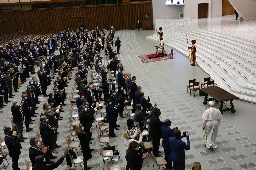 Pope Francis arrives to meet with the participants to the inter-parliamentary meeting on the COP26 in the Paul VI Hall at the Vatican, Saturday, Oct. 9, 2021. (AP Photo/Gregorio Borgia)