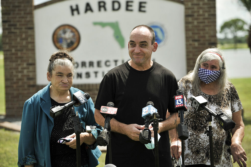 In this Aug. 27 2020 file photo, former inmate Robert DuBoise, 56, meets reporters with his sister Harriet, left, and mother Myra, right, outside the Hardee County Correctional Institute after serving 37 years in prison, when officials discovered new evidence that proved his innocence in Hardee County, Fla. DuBoise, exonerated of a 1983 rape and murder after serving 37 years in prison is suing over his wrongful conviction in which a a questionable bite mark was critical evidence. (AP Photo/Steve Nesius, File)