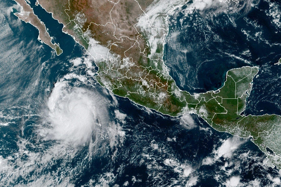 This satellite image provided by the National Oceanic and Atmospheric Administration (NOAA) shows a Tropical Storm Pamela in the Pacific as it approaches Mexico at 15:30Oz, or 11:30 am EST, Monday, Oct. 11, 2021. Pamela was forecast to take a turn toward the north and northeast, passing close to the southern tip of the Baja California peninsula late Tuesday or early Wednesday at hurricane strength, and forecast to make landfall Wednesday near Mazatlan, potentially as a Category 3 hurricane. (NOAA/NESDIS/STAR GOES via AP)