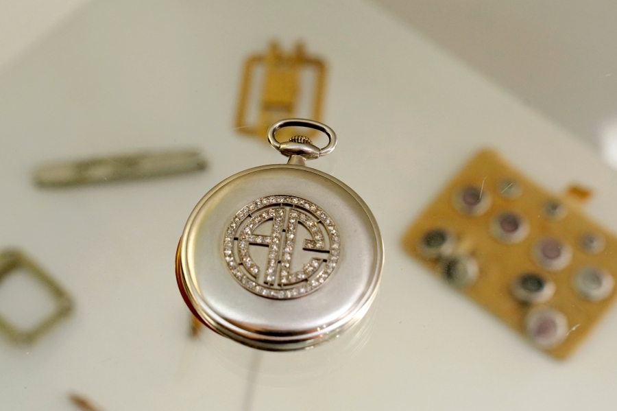 A platinum and diamond Patek Philippe pocket watch with the initials AC that once belonged to mob boss Al Capone is displayed at Witherell's Auction House in Sacramento on Aug. 25, 2021. (Rich Pedroncelli / Associated Press)