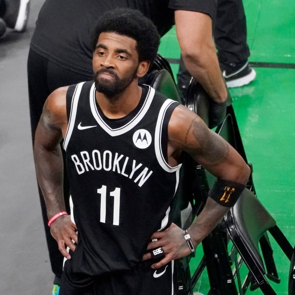 Brooklyn Nets guard Kyrie Irving looks up at the fans at TD Garden after they defeated the Boston Celtics in Game 4 during an NBA basketball first-round playoff series in Boston, in this Sunday, May 30, 2021, file photo. (AP Photo/Elise Amendola, File)