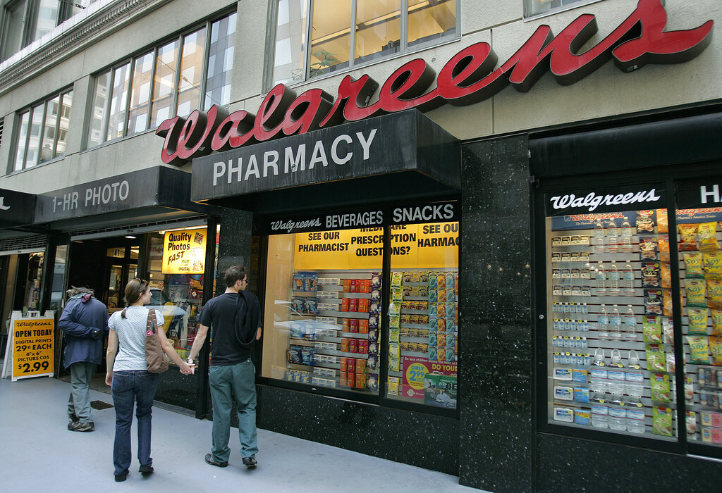 In this June 26, 2006 file photo, window shoppers look at a Walgreens storefront in San Francisco. (AP Photo/Ben Margot, File)