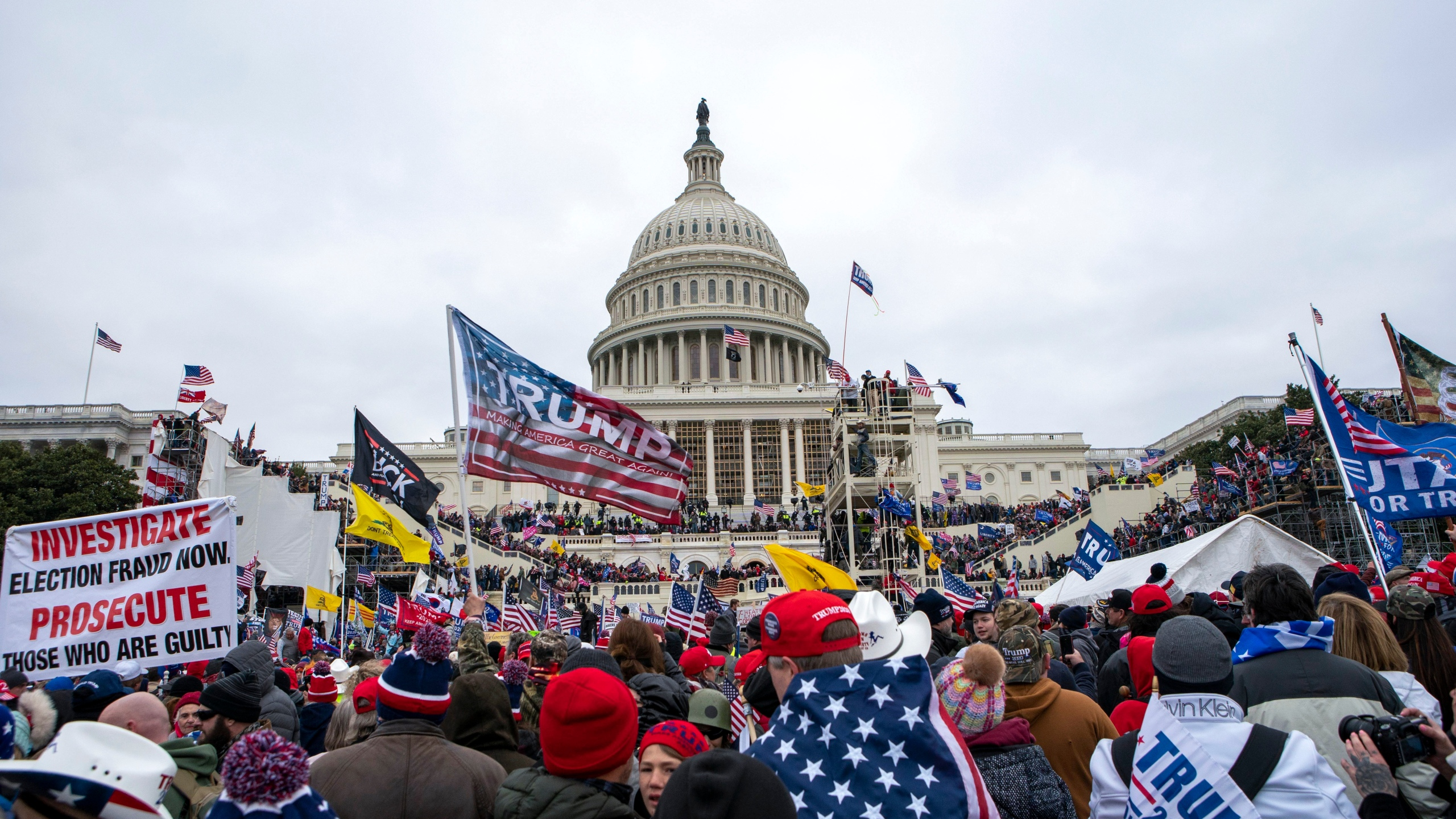 In this Jan. 6, 2021, file photo insurrections loyal to President Donald Trump rally at the U.S. Capitol in Washington. A federal judge held the director of the District of Columbia's Department of Corrections and the warden of the city's jail in contempt of court on Wednesday, Oct. 13, and asked the Justice Department to investigate whether the civil rights of inmates are being abused. U.S. District Judge Royce Lamberth had hauled the jail officials into court as part of the criminal case into Christopher Worrell, a member of the Proud Boys who has been charged in the Jan. 6 attack at the U.S. Capitol. (AP Photo/Jose Luis Magana, File)