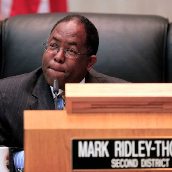 In this Jun 1, 2010, photo, Los Angeles County Supervisor Mark Ridley-Thomas casts the deciding vote for the Board of Supervisors 3-2 vote to join the city in its economic boycott of Arizona over its SB 1070 law targeting illegal immigrants in Los Angeles. Longtime politician Mark Ridley-Thomas and the former dean of the School of Social Work at USC were indicted Thursday, Oct. .14, 2021, on federal corruption charges that allege a bribery scheme in which a Ridley-Thomas relative received substantial benefits from the university in exchange for Ridley-Thomas supporting county contracts and lucrative contract amendments with the university while he served on the Los Angeles County Board of Supervisors. (AP Photo/Damian Dovarganes)