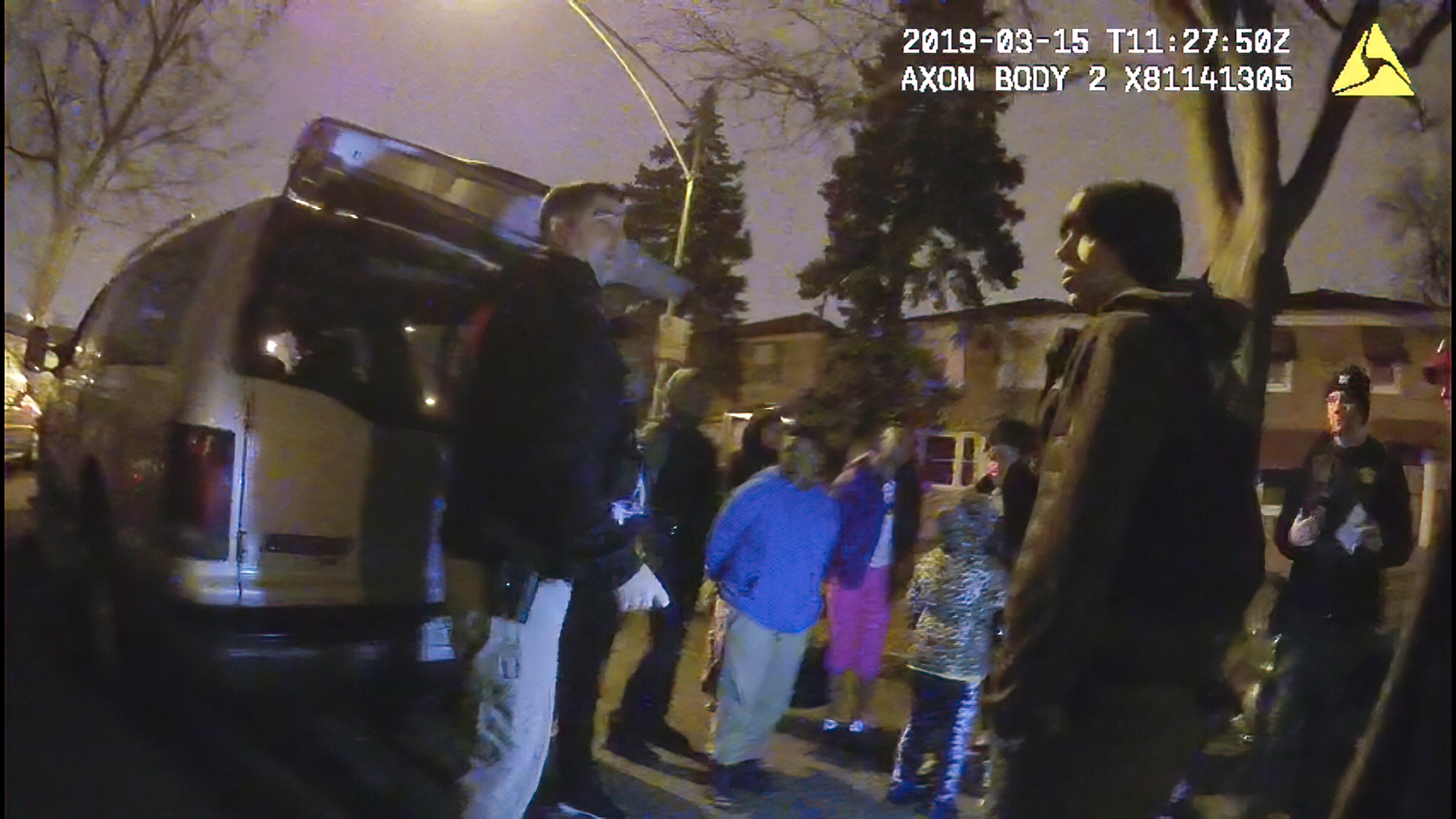 This image provided by the Chicago Police Department shows an image from video from a police worn body camera on March 15, 2019, in Chicago. Royal Smart, 8, in blue was handcuffed by police in south Chicago. Police were looking for illegal weapons and found none. No one was arrested. (Chicago Police Department via AP)