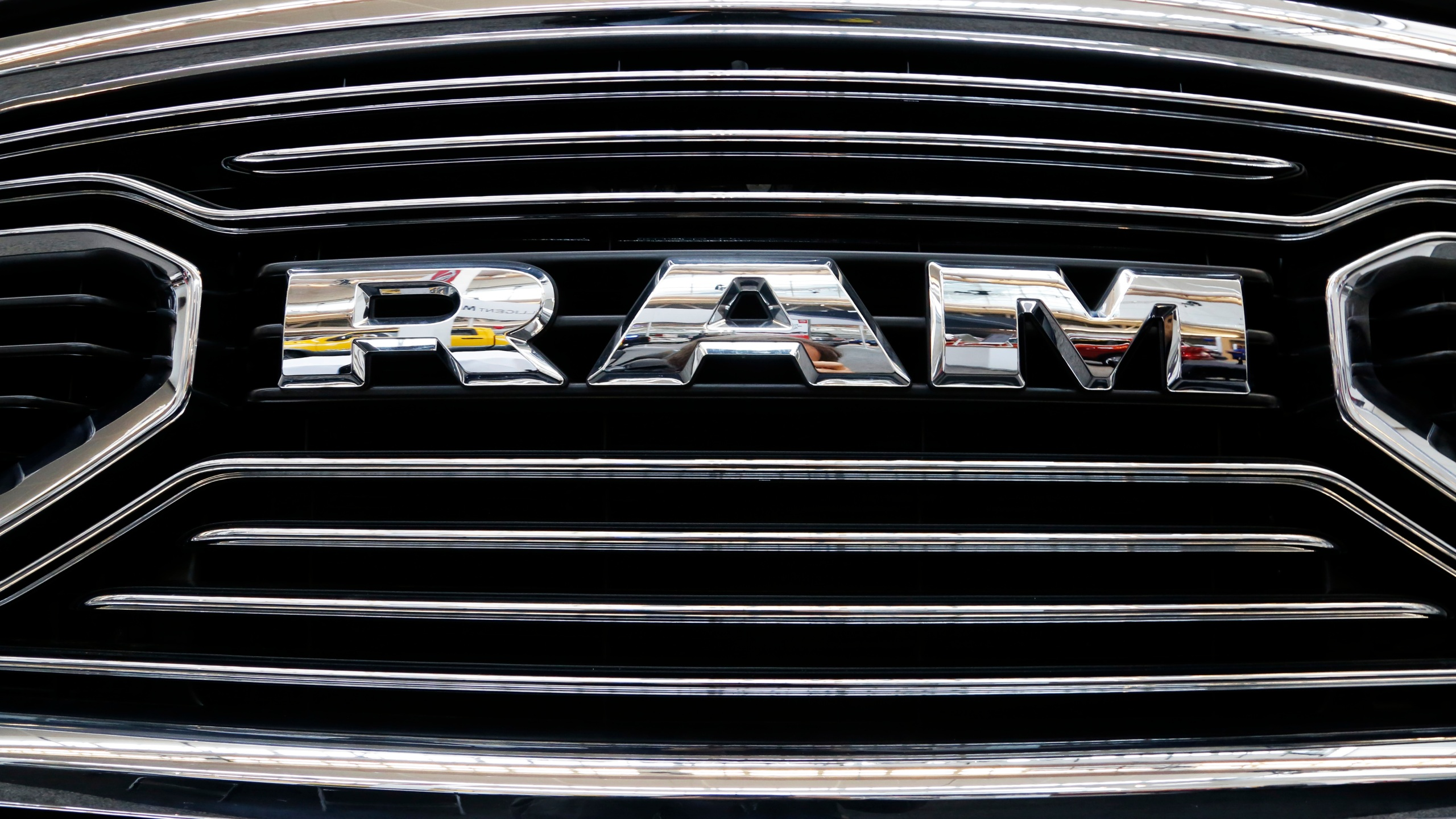 This is the grill of a 2018 Ram truck on display at the Pittsburgh Auto Show, in a Thursday, Feb. 15, 2018, file photo. U.S. safety regulators are investigating fuel pump failures in more than 600,000 diesel Ram trucks that could cause the engines to stall or lose power. The National Highway Traffic Safety Administration says in documents posted on its website Monday, Oct. 18, 2021, that it received 22 complaints and two field reports of engines stalling due to high-pressure fuel pumps failing.(AP Photo/Gene J. Puskar, File)