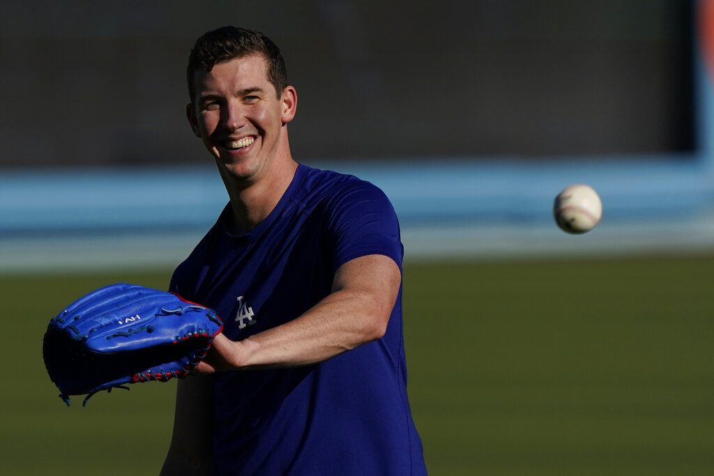 Los Angeles Dodgers starting pitcher Walker Buehler warms up during a workout ahead of Game 3 of baseball's National League Championship Series against the Atlanta Braves, Monday, Oct. 18, 2021, in Los Angeles. (AP Photo/Marcio Jose Sanchez)