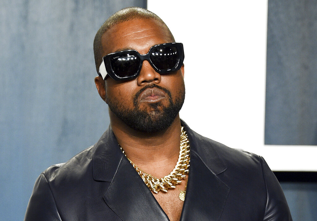 In this Feb. 9, 2020, file photo, Kanye West arrives at the Vanity Fair Oscar Party in Beverly Hills, Calif. On Monday, Oct. 18, 2021, a Los Angeles judge approved the request of the rapper, producer and fashion designer to legally change his name to just Ye, spelled Y-E, with no middle or last name. (Photo by Evan Agostini/Invision/AP, File)