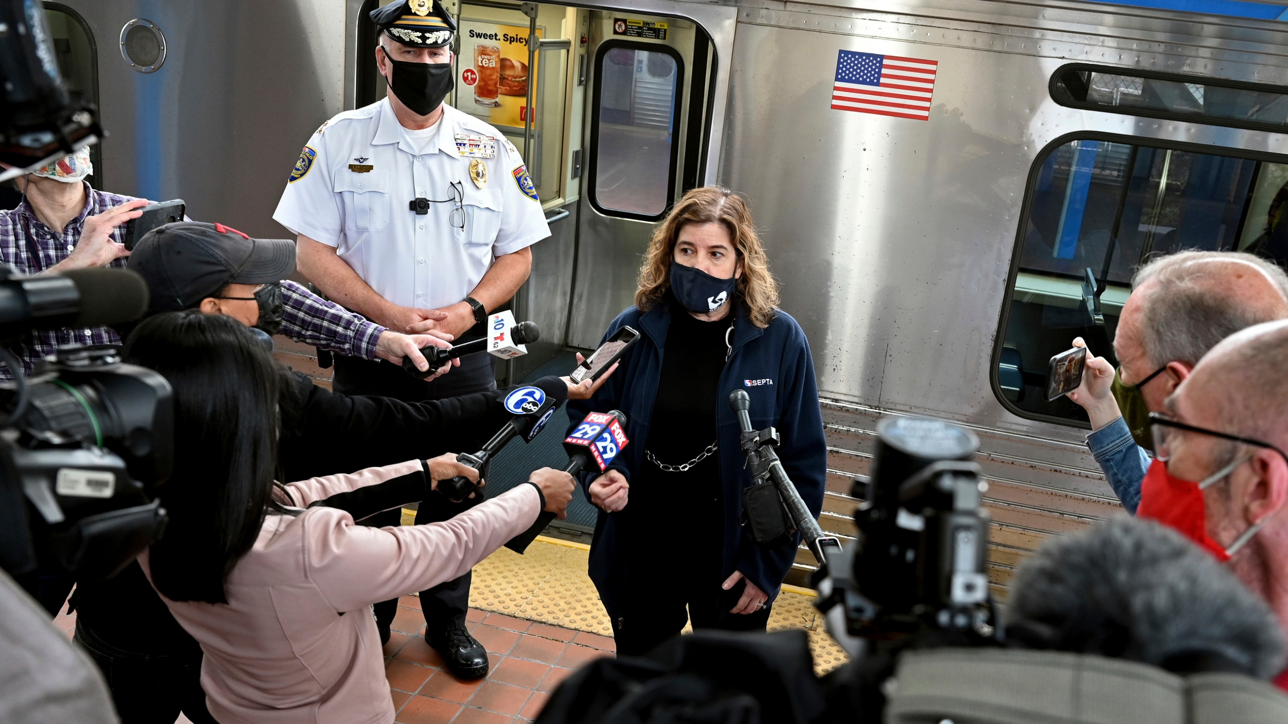SEPTA General Manager Leslie Richards speaks during a news conference as SEPTA Transit Police Chief Thomas Nestel III stands behind her on an El platform at the 69th Street Transportation Center, Monday, Oct. 18, 2021, in Philadelphia, following a brutal rape on the El, as other riders watched, over the weekend. They discussed the emergency call boxes on SEPTA trains and how to properly contact police from the trains. (Tom Gralish/The Philadelphia Inquirer via AP)