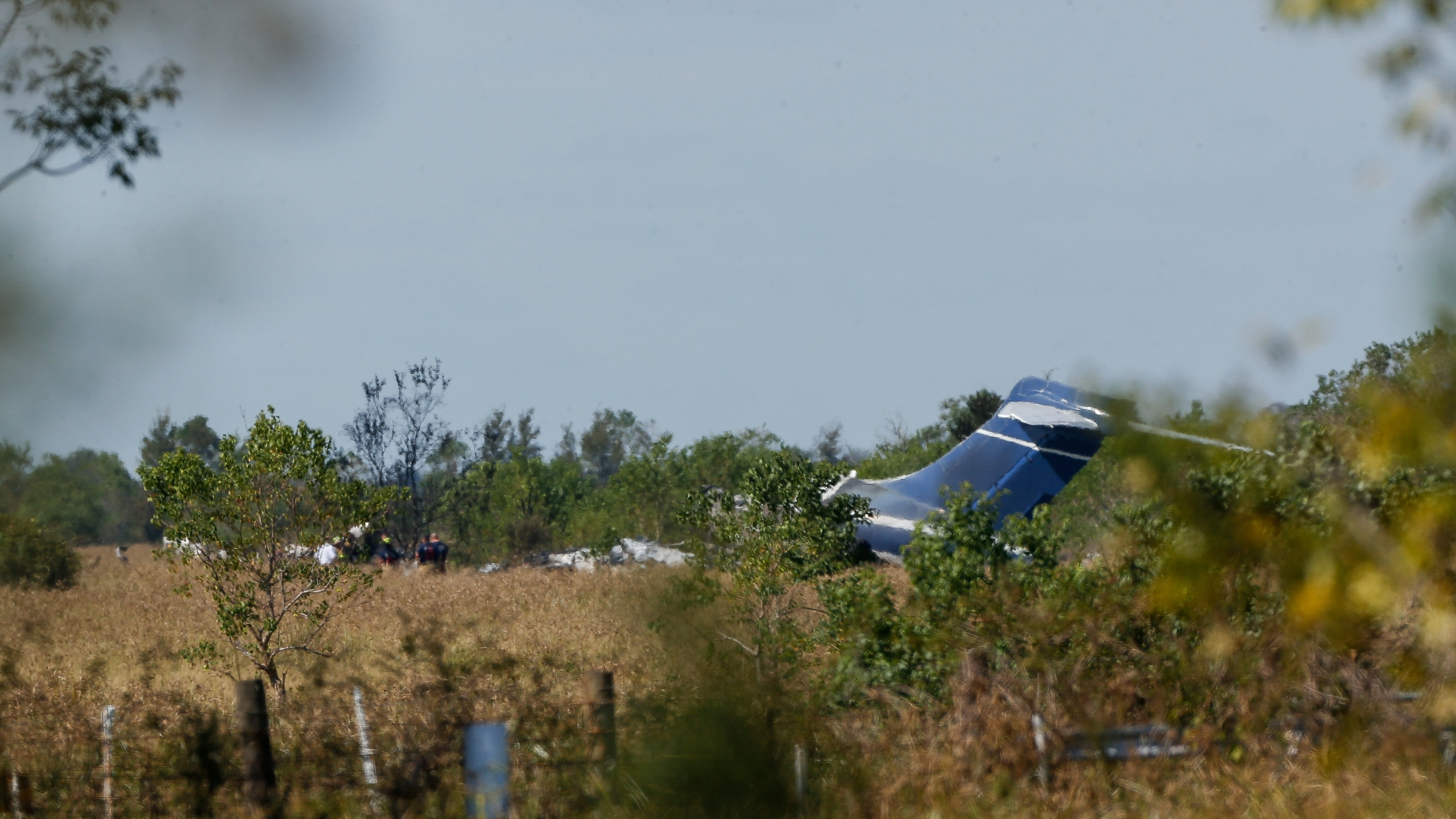 Remnants of an aircraft can be seen at the site of airplane crash near the intersection of Morton Road and FM 2855, on Tuesday, Oct. 19, 2021, in Brookshire, Texas. No one was seriously hurt when the airplane bound for Boston ran off a runway and burned Tuesday morning near Houston, authorities said. ( odofredo A. Vásquez/Houston Chronicle via AP)