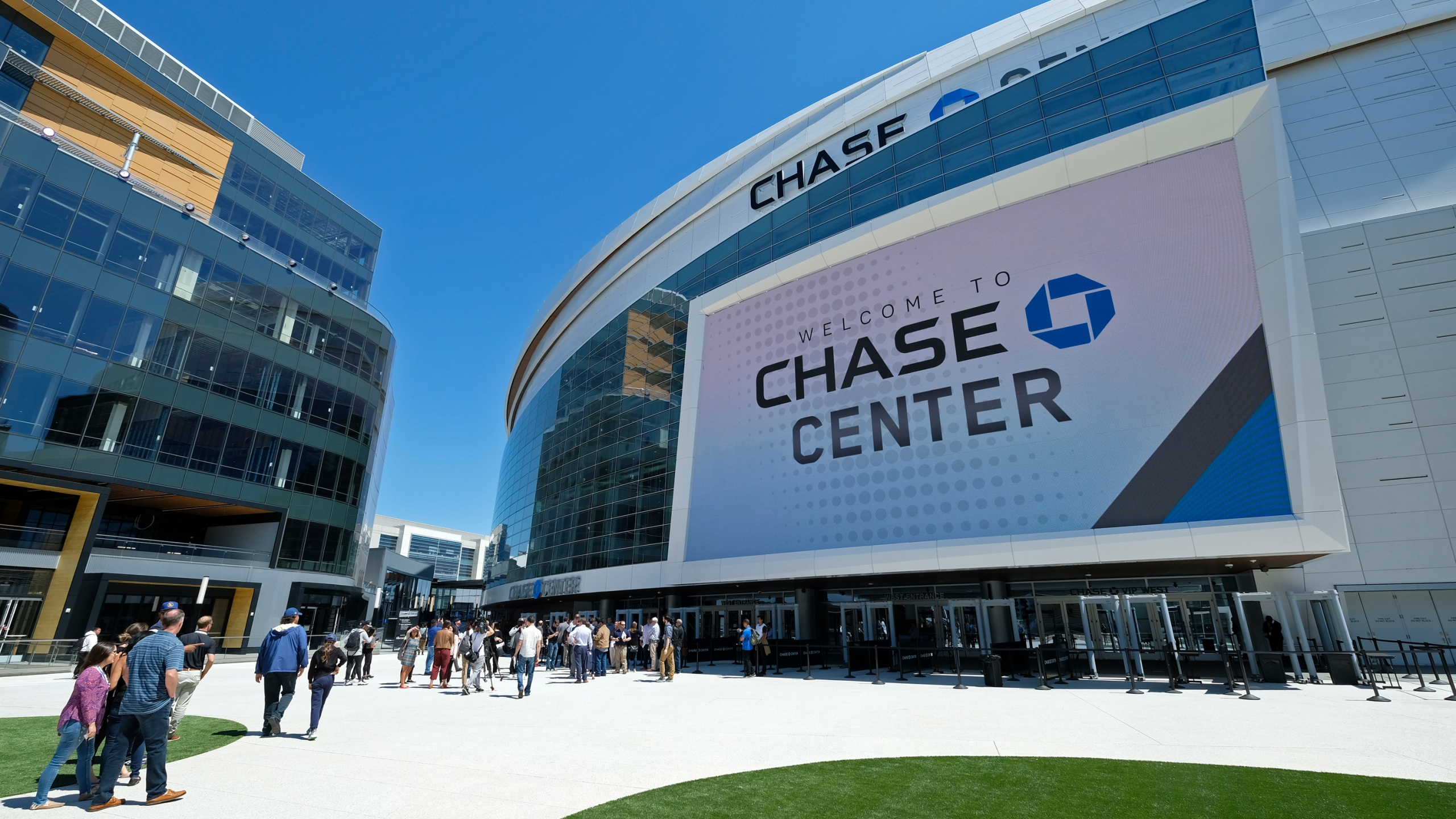 In this Aug. 26, 2019, file photo, people walk outside the Chase Center in San Francisco. (Eric Risberg/Associated Press)