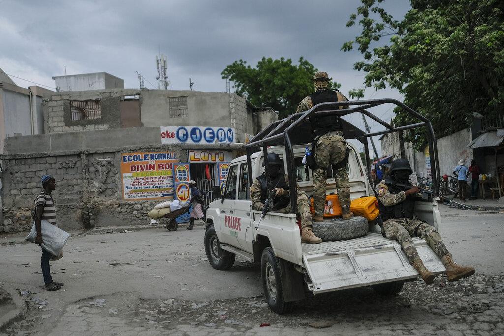 Security forces patrol the streets of Croix-des-Bouquets, near Port-au-Prince, Haiti, Tuesday, Oct. 19, 2021. (AP Photo/Matias Delacroix)