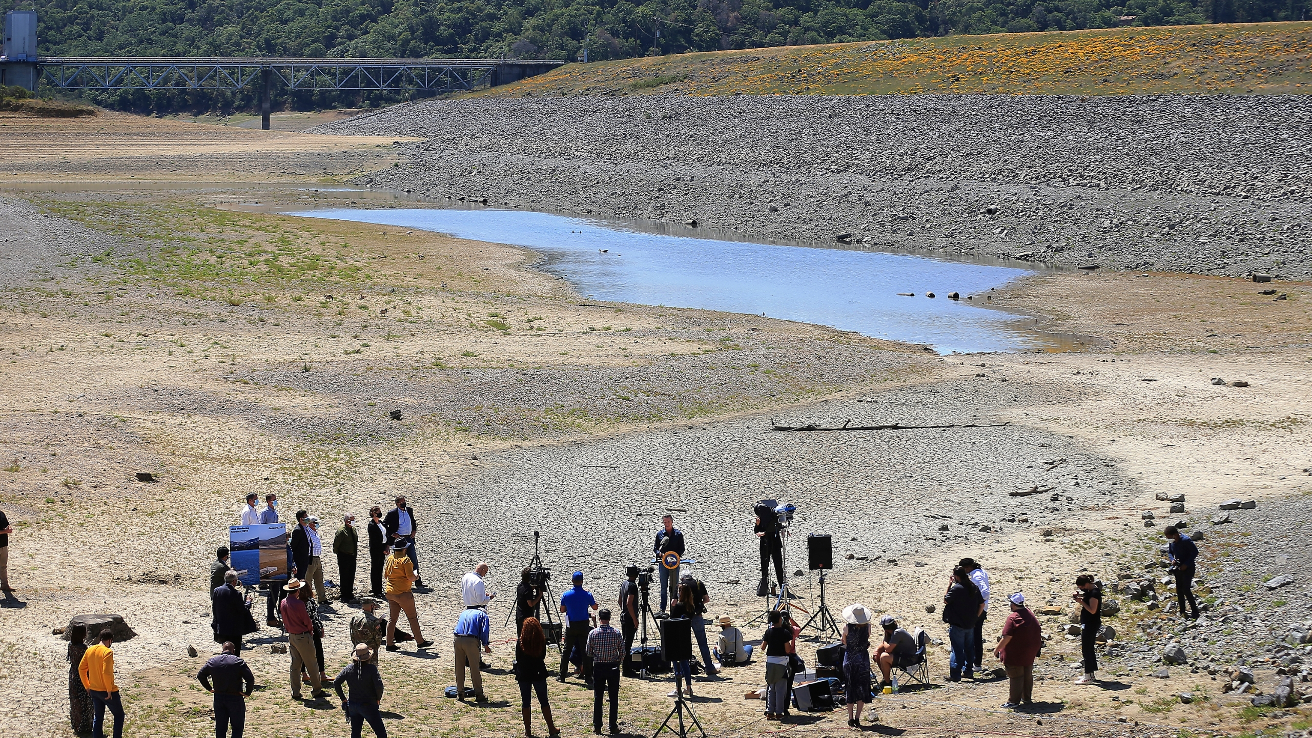 In this April 21, 2021, file photo, California Gov. Gavin Newsom holds a news conference in the parched basin of Lake Mendocino in Ukiah, Calif., where he announced he would proclaim a drought emergency for Mendocino and Sonoma counties. (Kent Porter/The Press Democrat via AP, File)