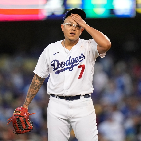 Los Angeles Dodgers pitcher Julio Urias reacts after giving up an RBI single to Atlanta Braves' Joc Pederson during the third inning in Game 4 of baseball's National League Championship Series Wednesday, Oct. 20, 2021, in Los Angeles. (AP Photo/Jae Hong)