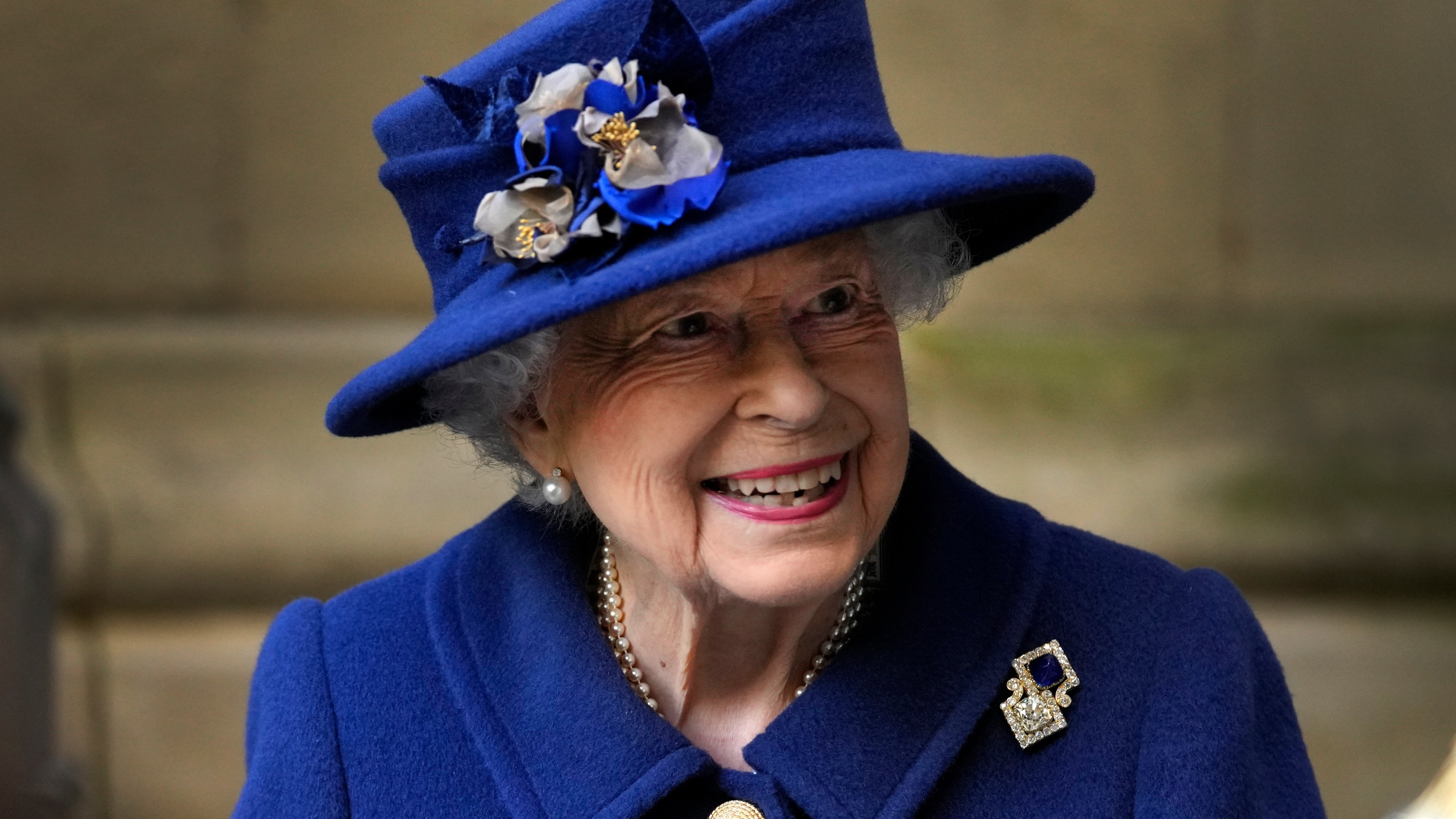 In this Oct. 12, 2021, file photo, Britain's Queen Elizabeth II, Patron, leaves after attending a Service of Thanksgiving to mark the Centenary of the Royal British Legion at Westminster Abbey in London. (AP Photo/Frank Augstein, Pool, File)