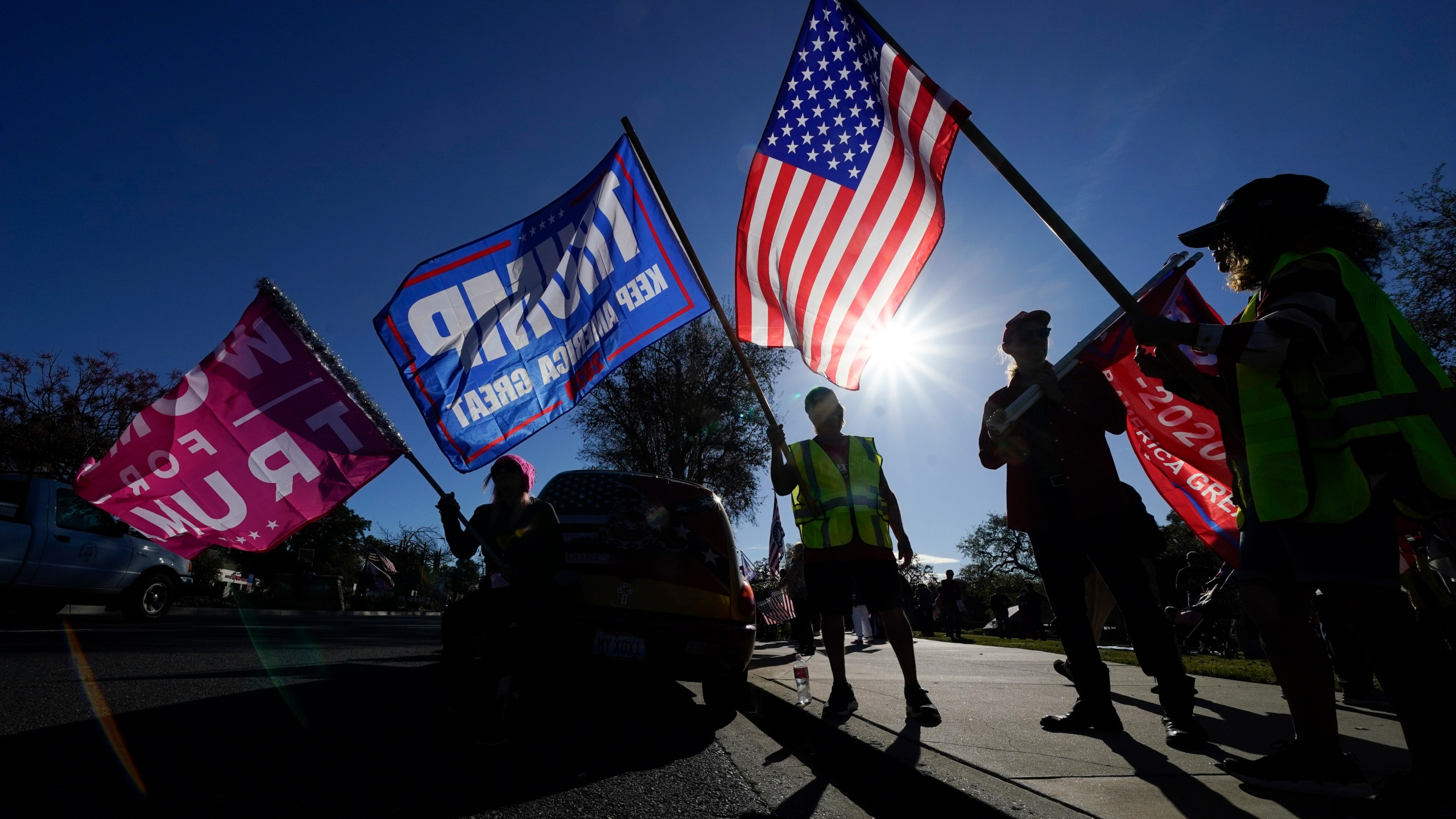 In this Jan. 6, 2021 file photo, people attend a rally in support of President Donald Trump outside Thousand Oaks City Hall in Thousand Oaks, Calif. (AP Photo/Ashley Landis, File)