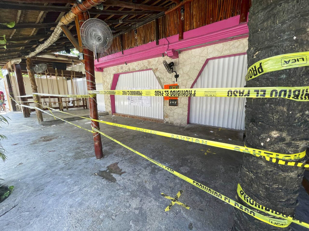 Police security tape covers the exterior of a restaurant the day after a fatal shooting in Tulum, Mexico, Friday, Oct. 22, 2021. (AP Photo/Christian Rojas)