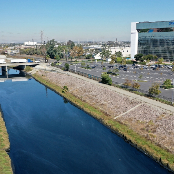 This Thursday, Oct. 21, 21021, aerial image taken with a drone, shows the Dominguez Channel flowing through Carson, Calif. Levels of wretched-smelling hydrogen sulfide gas that have plagued south Los Angeles County communities for weeks are declining as authorities use various mitigation methods in a flood control channel emitting the gross odors, officials said Friday. (Dean Musgrove/The Orange County Register via AP)
