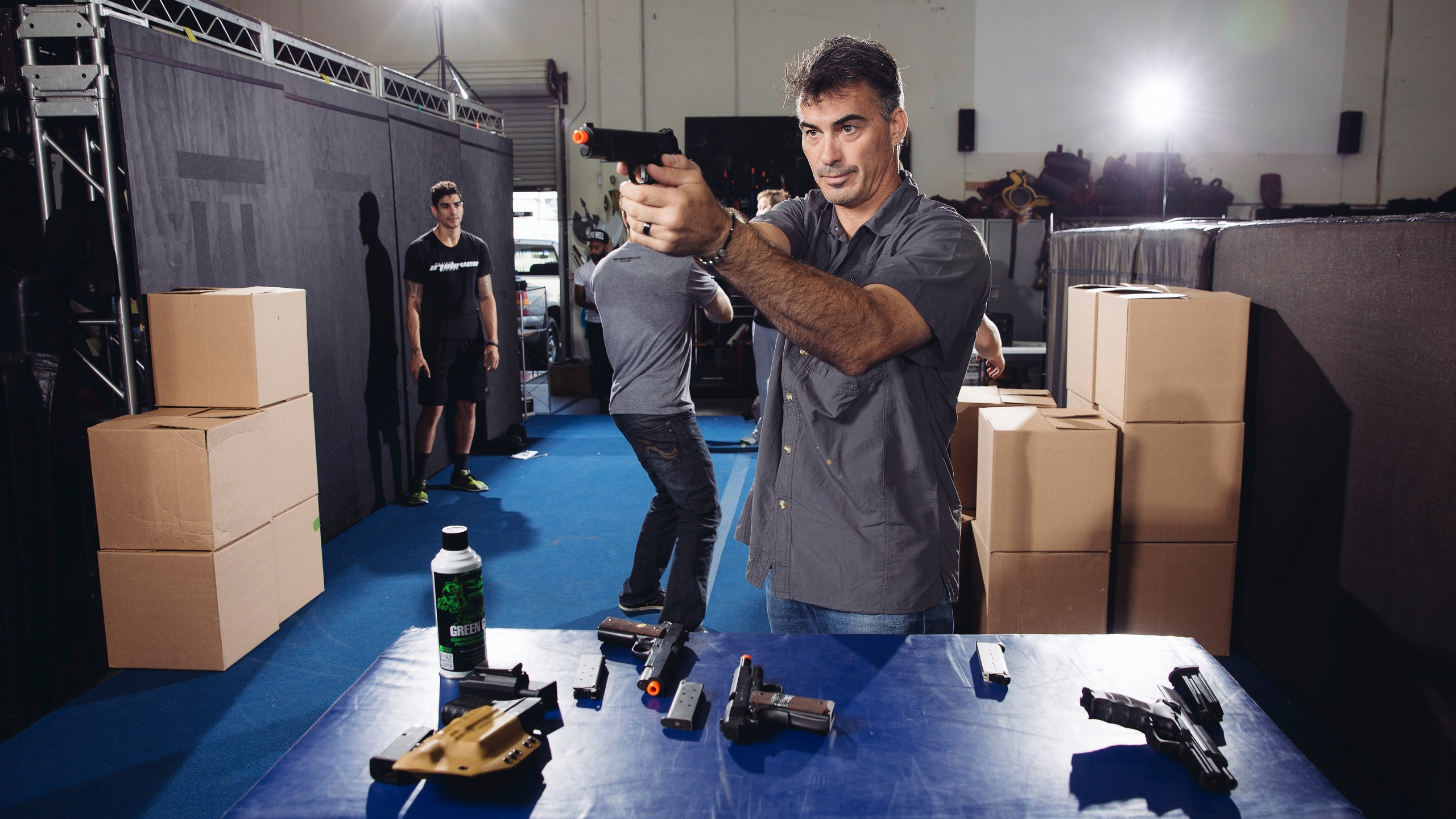 """In this Oct. 7, 2014 photo, Chad Stahelski, co-director of the film, """"John Wick,"""" demonstrates proper gun handling during a training session at 87Eleven Action Design in Inglewood, Calif. (Photo by Casey Curry/Invision/AP, File)"""
