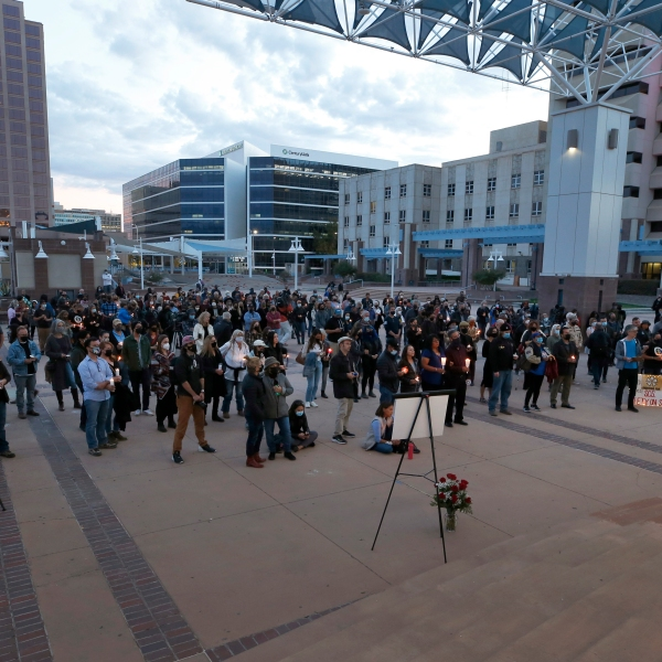 A large crowd of movie industry workers and New Mexico residents attend a candlelight vigil to honor cinematographer Halyna Hutchins in downtown Albuquerque, N.M. Saturday, Oct. 23, 2021. (AP Photo/Andres Leighton, file)