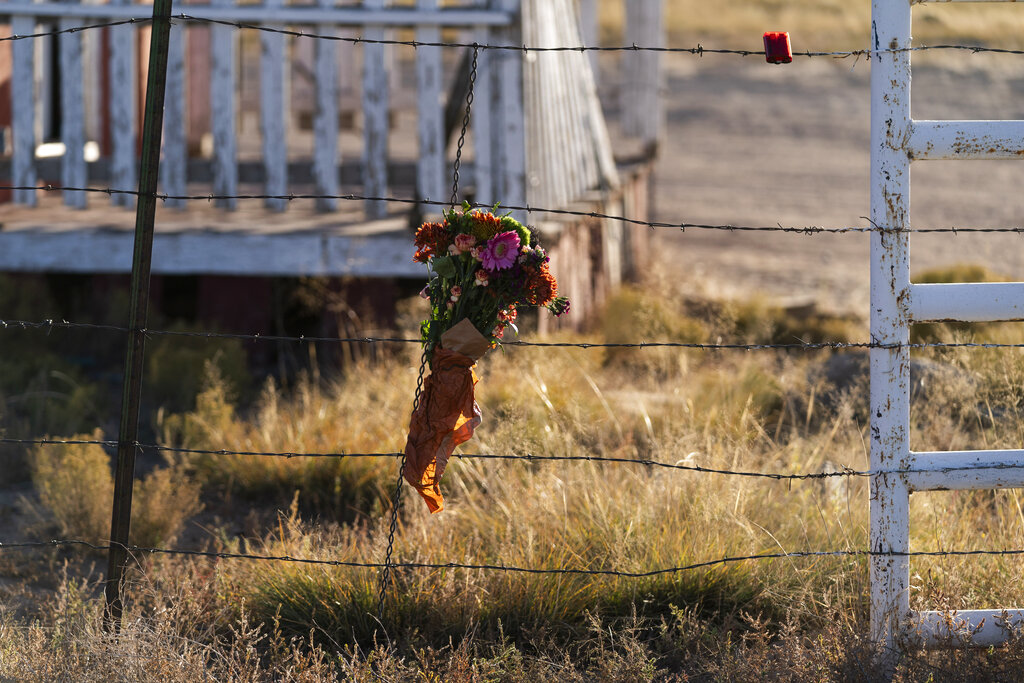 A bouquet of flowers is left to honor cinematographer Halyna Hutchins outside the Bonanza Creek Ranch in Santa Fe, N.M., Sunday, Oct. 24, 2021. (AP Photo/Jae C. Hong)