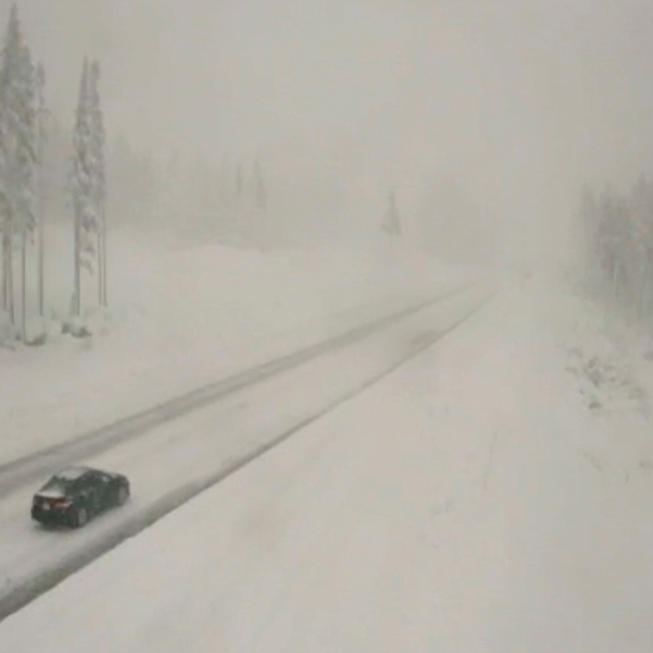 In this image taken from video from a Caltrans remote video traffic camera, very light traffic is seen in the snow along Interstate 80 at Donner Summit, Calif., Monday, Oct. 25, 2021. Rainfall records were shattered and heavy snow pounded high elevations of the Sierra Nevada. Officials said mountain areas above 9,000 feet (2,745 meters) in the Sierra Nevada could get 18 inches (46 centimeters) of snow or more from Sunday until Monday morning. (Caltrans via AP)