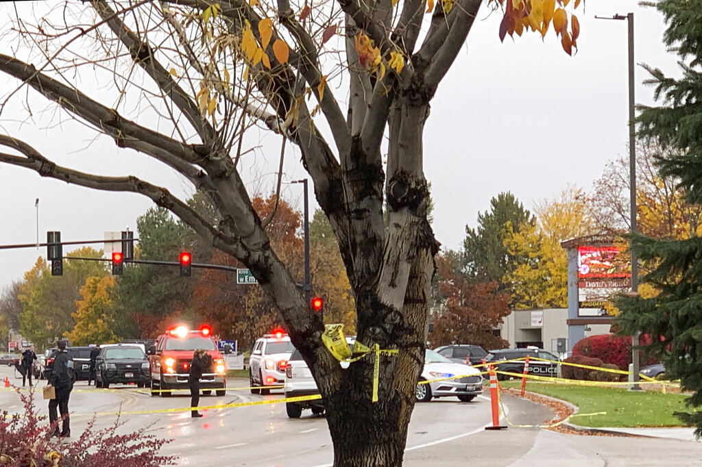 Police close off a street outside a shopping mall after a shooting in Boise, Idaho on Monday, Oct. 25, 2021. (AP Photo/Rebecca Boone)