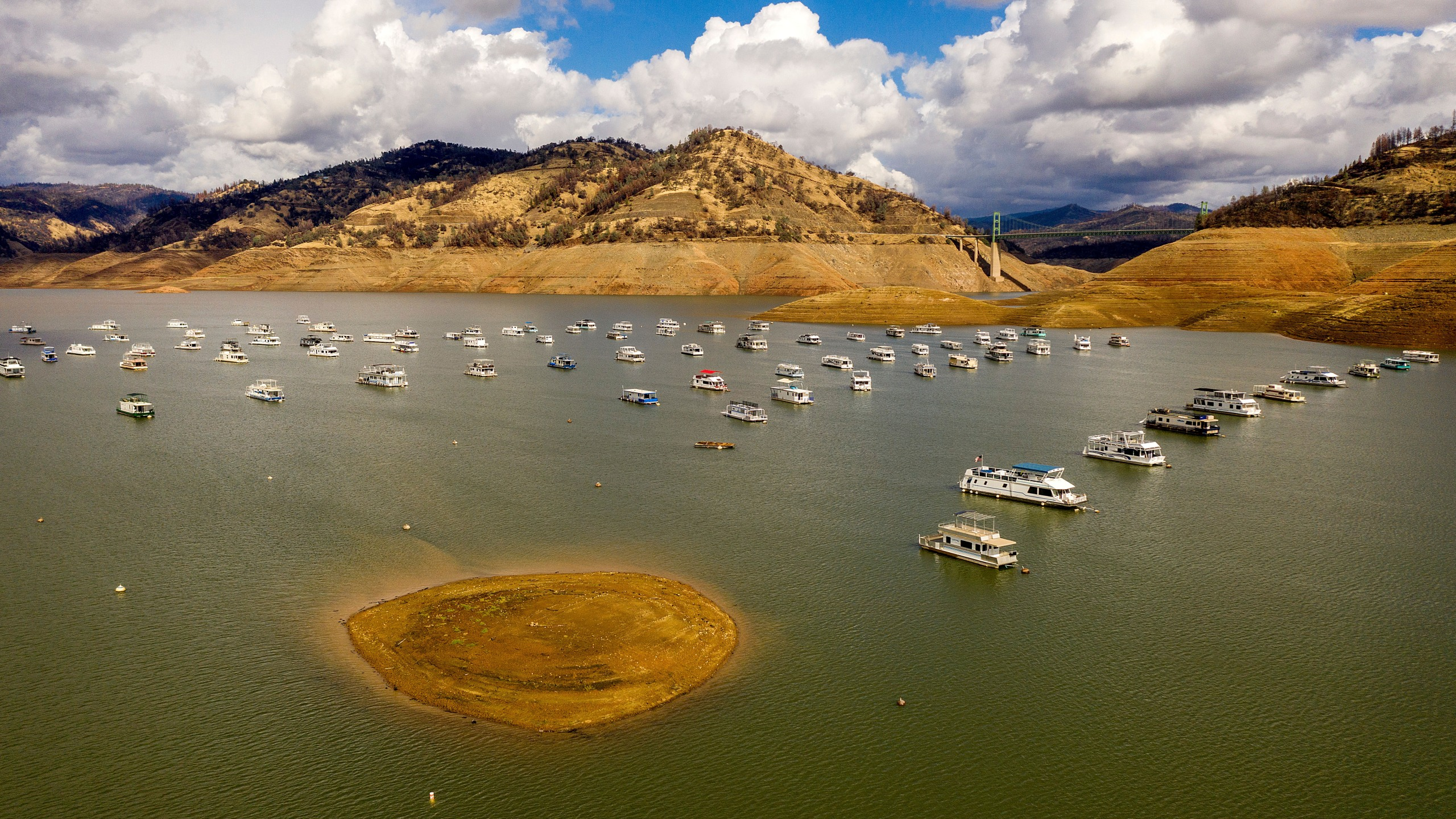 Houseboats float on Lake Oroville, Monday, Oct. 25, 2021, in Oroville, Calif. Recent storms raised the reservoir more than 16 feet, according to the California Department of Water Resources. (AP Photo/Noah Berger)