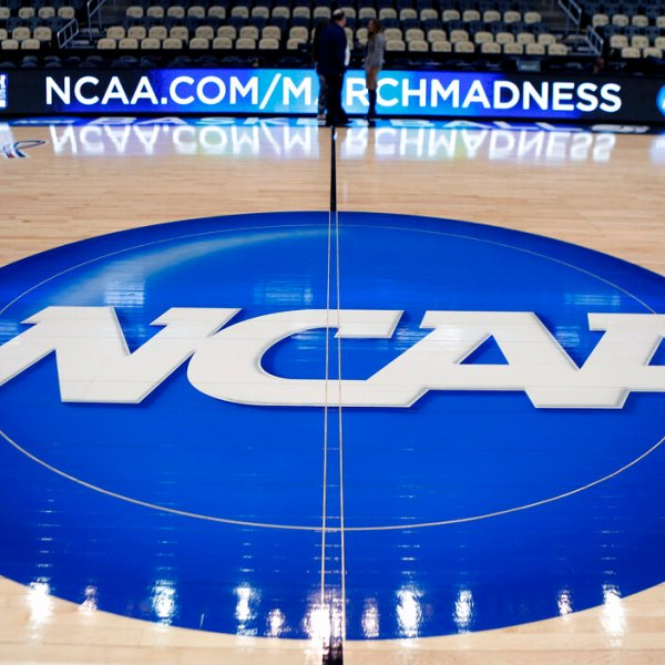 In this March 18, 2015, file photo, the NCAA logo is displayed at center court as work continues at The Consol Energy Center in Pittsburgh, for the NCAA college basketball tournament. (AP Photo/Keith Srakocic, File)