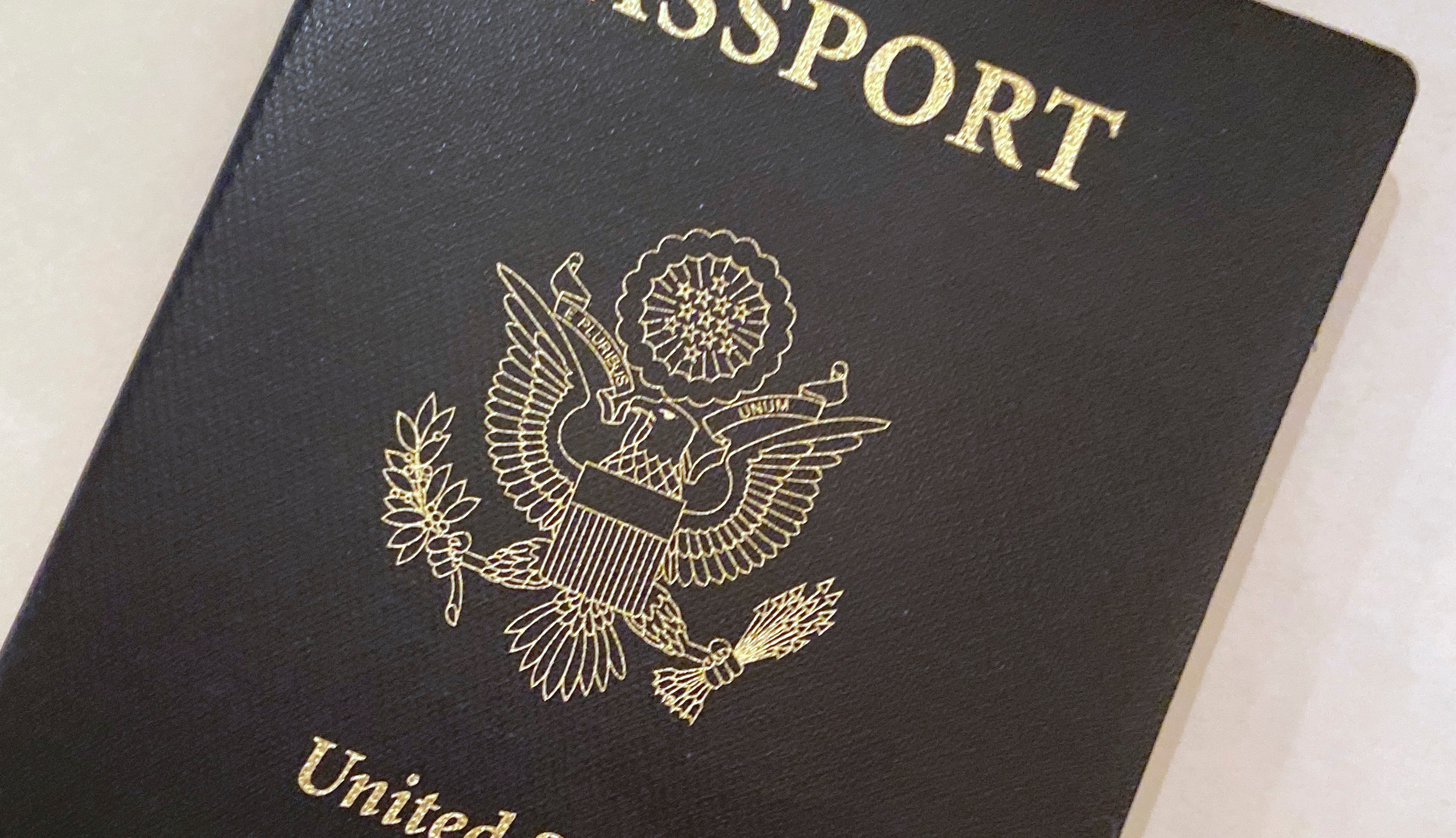 """This May 25, 2021 file photo shows a U.S. Passport cover in Washington. The United States has issued its first passport with an """"X"""" gender designation, a milestone in the recognition of the rights of people who don't identify as male or female. (AP Photo/Eileen Putman)"""
